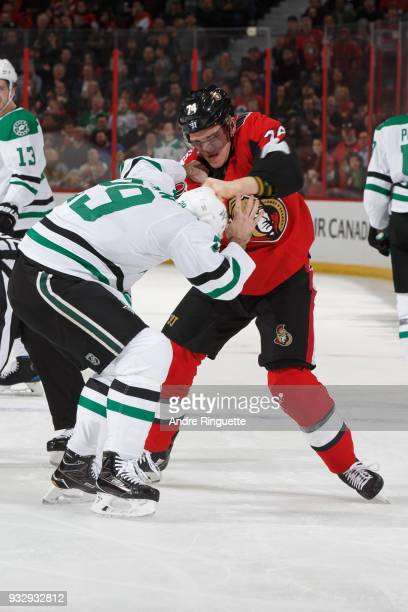 Mark Borowiecki of the Ottawa Senators fights with Greg Pateryn of the Dallas Stars during first period action at Canadian Tire Centre on March 16...