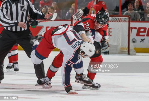 Mark Borowiecki of the Ottawa Senators fights with Josh Anderson of the Columbus Blue Jackets at Canadian Tire Centre on December 14 2019 in Ottawa...