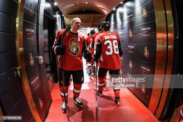 Mark Borowiecki of the Ottawa Senators highfives teammates including Rudolfs Balcers in the players' tunnel before warmup prior to a game against the...