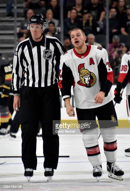 Mark Borowiecki of the Ottawa Senators is escorted off the ice after fighting during the first period against the Vegas Golden Knights at TMobile...