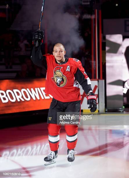 Mark Borowiecki of the Ottawa Senators salutes the crowd ahead of a game against the Chicago Blackhawks at Canadian Tire Centre on October 4 2018 in...