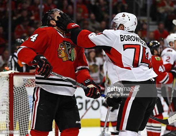 Mark Borowiecki of the Ottawa Senators shoves Richard Panik of the Chicago Blackhawks in the face at the United Center on December 20 2016 in Chicago...