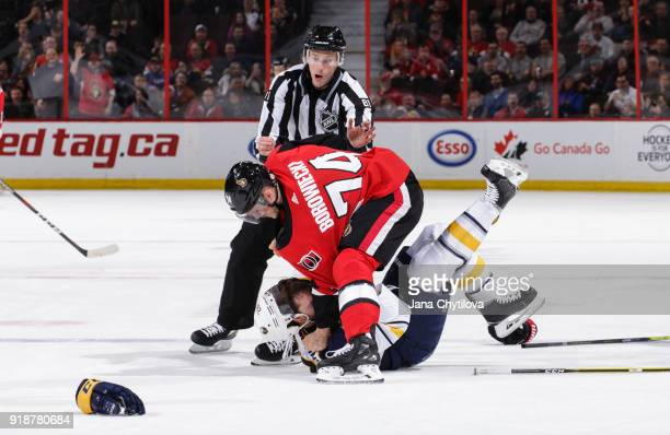 Mark Borowiecki of the Ottawa Senators throws Zemgus Girgensons of the Buffalo Sabres to the ice as they throw punches in the first period at...