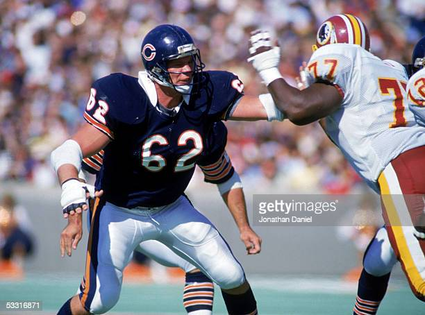 Mark Bortz of the Chicago Bears blocks Darryl Grant of the Washington Redskins during the game at Soldier Field on September 29 1985 in Chicago...