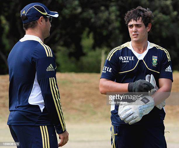 Mark Boucher chats to Quinton de Kock during the South African national cricket team nets session and press conference at Claremont Cricket Club on...