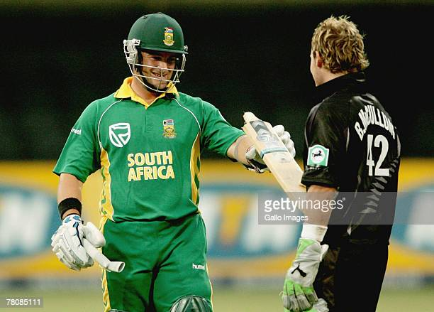 Mark Boucher gets his broken bat back from Brendon McCullum during the first ODI match between South Africa and New Zealand held at Sarhara Stadium...