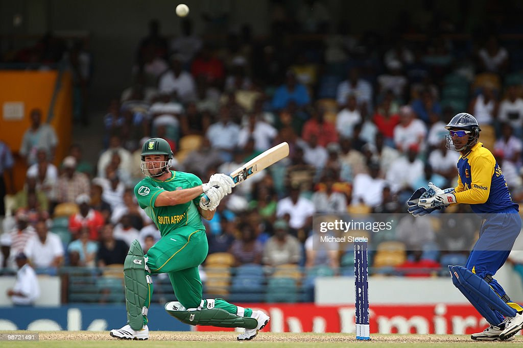 Mark Boucher of South Africa hits out as Kumar Sangakkara looks on during The ICC T20 World Cup warm up match between Sri Lanka and South Africa at the Kensington Oval on April 28, 2010 in Bridgetown, Barbados.