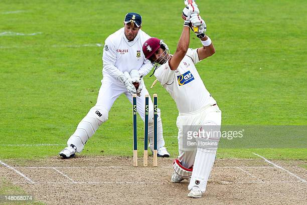 Mark Boucher of South Africa is hit in the face by a bail as Gemaal Hussain of Somerset is Bowled by Imran Tahir of South Africa during a friendly...