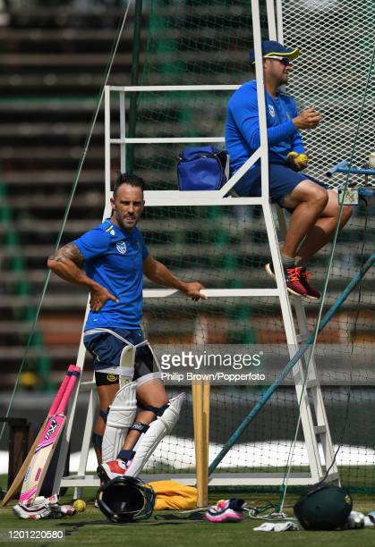 Mark Boucher of South Africa uses a bowling machine as Faf du Plessis looks on at the Wanderers during a training session before the fourth Test...
