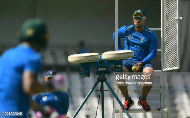 Mark Boucher of South Africa uses a bowling machine for Faf du Plessis at the Wanderers during a training session before the fourth Test match...