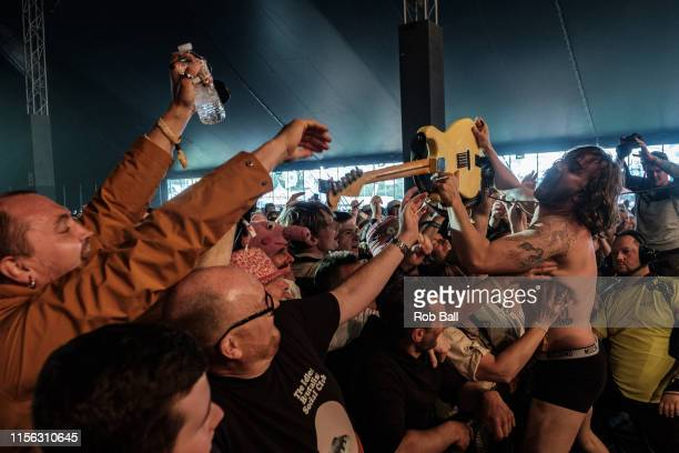 Mark Bowen from Idles performs on stage during Isle of Wight Festival 2019 at Seaclose Park on June 16 2019 in Newport Isle of Wight