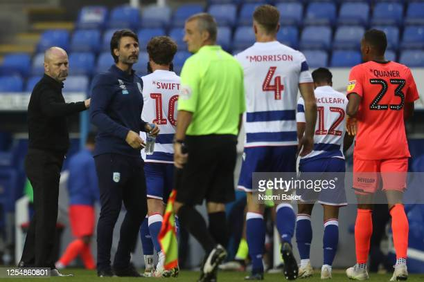 Mark Bowen the manager of Reading and Danny Cowley the manager of Huddersfield Town at the final whistle of the Sky Bet Championship match between...