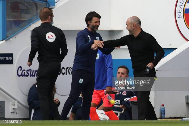 Mark Bowen the manager of reading greets Danny Cowley the manager of Huddersfield Town ahead of the Sky Bet Championship match between Reading and...