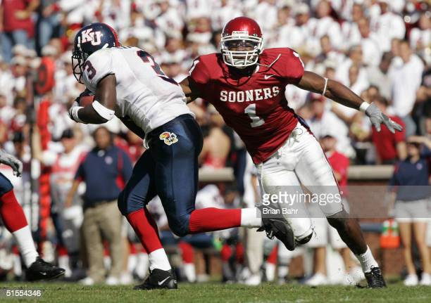 Mark Bradley of the Oklahoma Sooners closes in on punt returner Charles Gordon the Kansas Jayhawks in the third quarter on October 23, 2004 at...