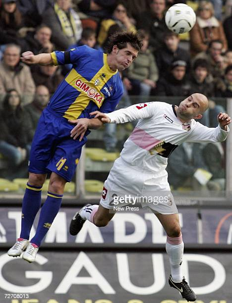 Mark Bresciano of Palermo goes up for a header with Vitali Kutuzov of Parma during the Serie A match between Parma and Palermo at the Stadio Ennio...