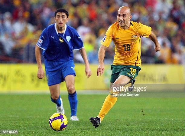 Mark Bresciano of the Socceroos dribbles the ball during the 2010 FIFA World Cup qualifying match between the Australian Socceroos and Uzbekistan at...