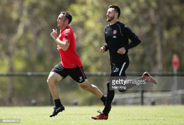 Mark Bridge and goalkeeper Vedran Janjetovic run during a Western Sydney Wanderers ALeague training session at Blacktown International Sportspark on...