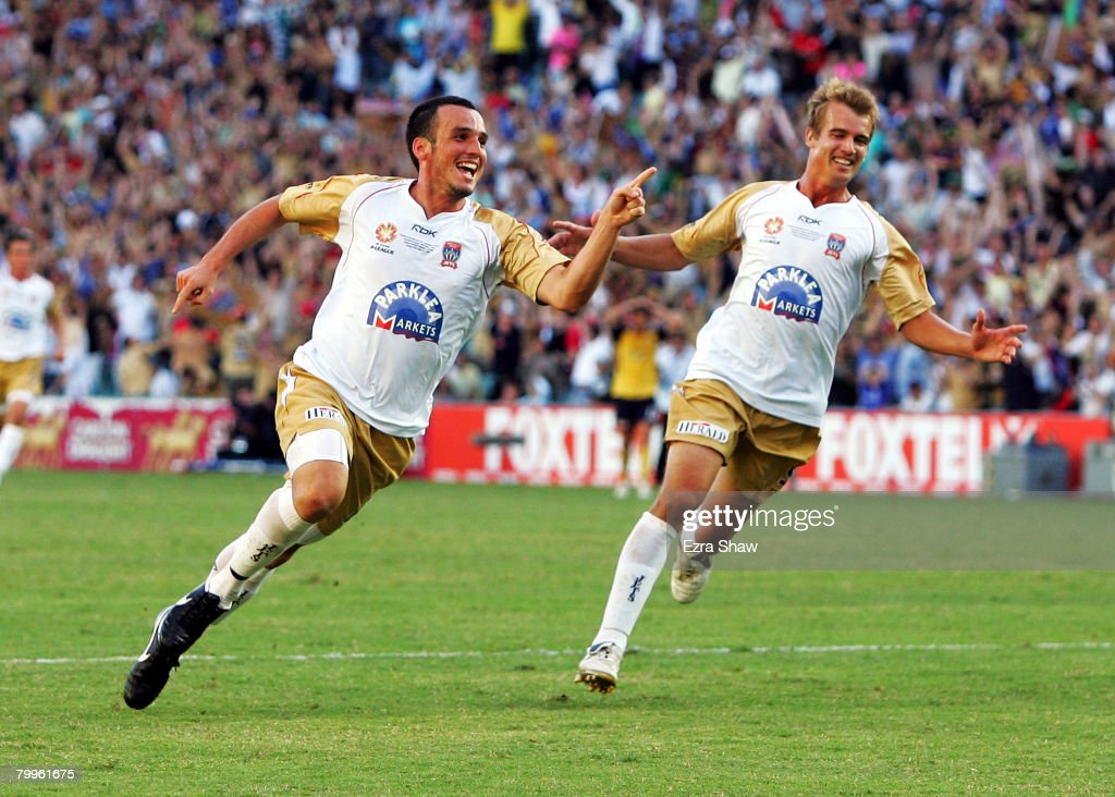 Mark Bridge and Joel Griffiths of the Jets celebrate after Bridge scored a goal during the A-League Grand Final match between the Central Coast Mariners and the Newcastle Jets at the Sydney Football Stadium on February 24, 2008 in Sydney, Australia.
