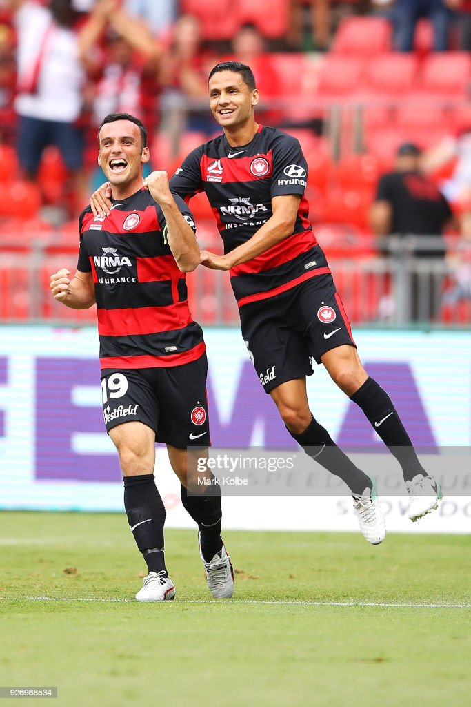 Mark Bridge and Marcelo Carrusca of the Wanderers celebrate Bridge scoring a goal during the round 23 A-League match between the Western Sydney Wanderers and the Perth Glory at Spotless Stadium on March 4, 2018 in Sydney, Australia.