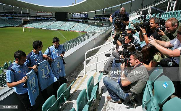 Mark Bridge John Aloisi and Simon Colosimo are surrounded by media following a press conference where it was announced that all three signed with...