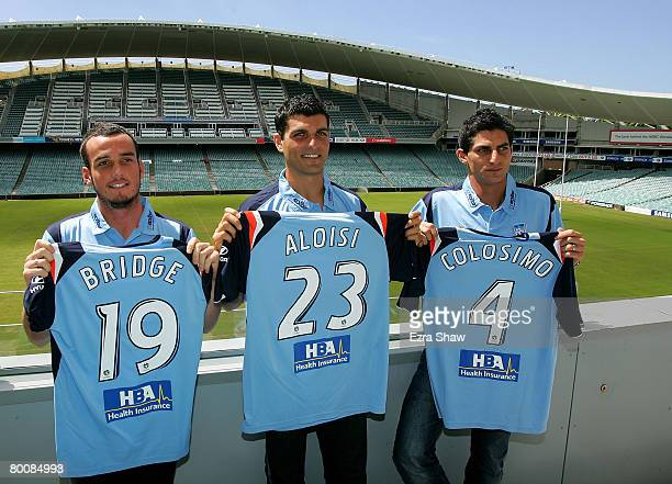 Mark Bridge John Aloisi and Simon Colosimo pose following a press conference where it was announced that all three signed with Sydney FC at the...