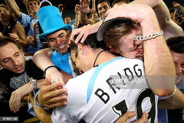 Mark Bridge of Sydney celebrates with fans after the ALeague Grand Final match between the Melbourne Victory and Sydney FC at Etihad Stadium on March...