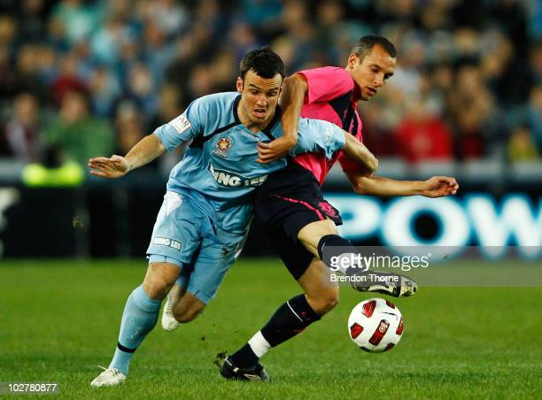 Mark Bridge of Sydney FC competes with Leon Osman of Everton during a preseason friendly match between Sydney FC and Everton FC at ANZ Stadium on...