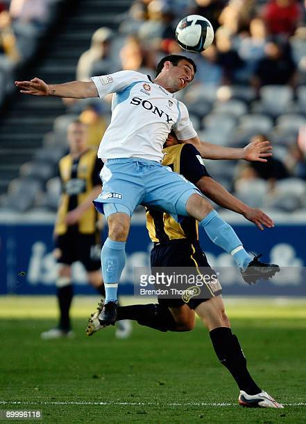 Mark Bridge of Sydney wins a header during the round three A-League match between the Central Coast Mariners and Sydney FC at Bluetongue Stadium on...