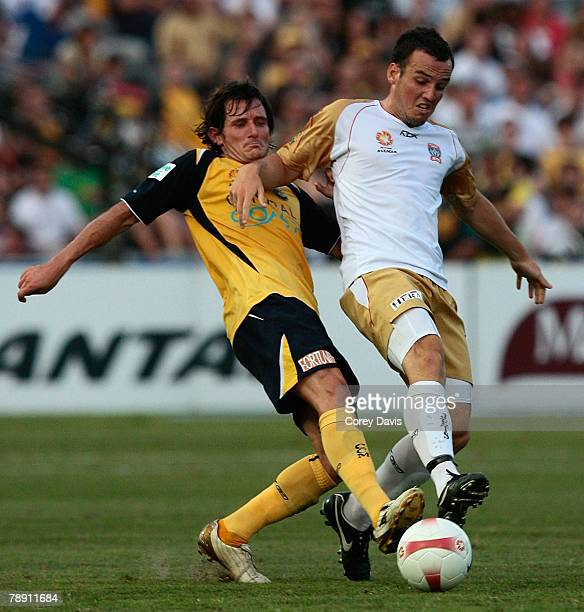 Mark Bridge of the Jets and Andrew Clark of the Mariners contest the ball during the round 20 ALeague match between the Central Coast Mariners and...