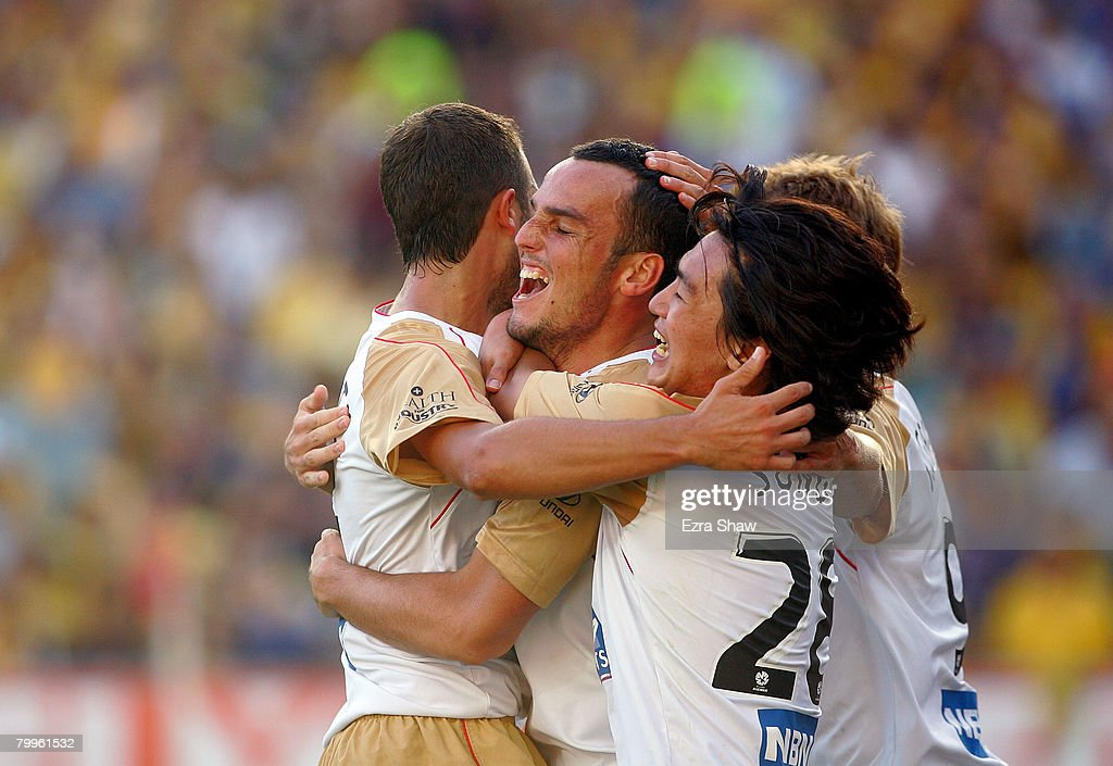 Mark Bridge of the Jets is congratulated by teammates after he scored a goal during the A-League Grand Final match between the Central Coast Mariners and the Newcastle Jets at the Sydney Football Stadium on February 24, 2008 in Sydney, Australia.