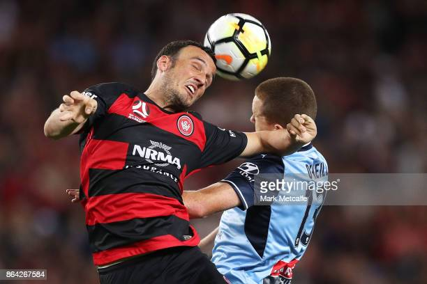 Mark Bridge of the Wanderers and Brandon O'Neill of Sydney FC compete for a header during the round three ALeague match between Sydney FC and the...