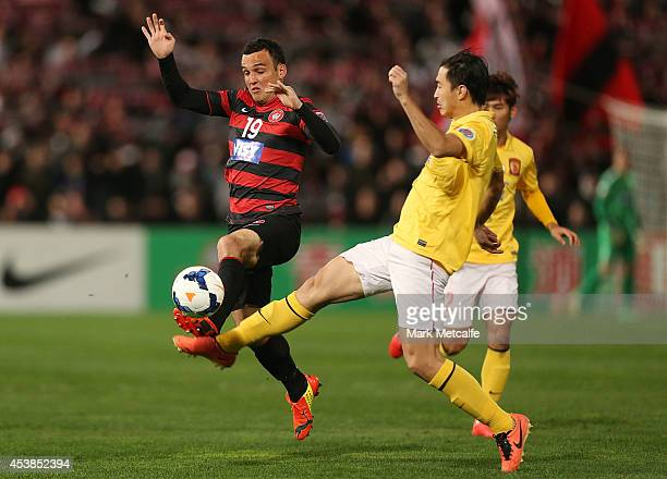 Mark Bridge of the Wanderers and Feng Xiaoting of Evergrande compete for the ball during the Asian Champions League Final match between the Western...