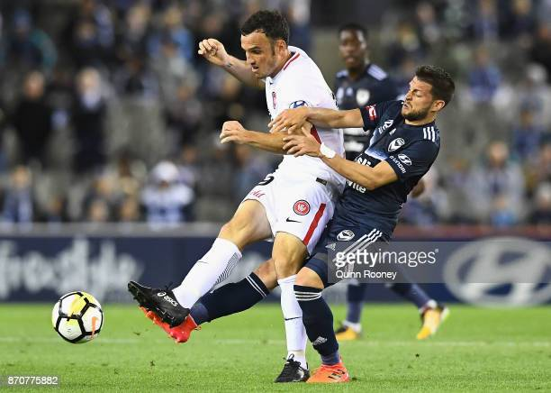 Mark Bridge of the Wanderers and Matias Sanchez of the Victory compete for the ball during the round five ALeague match between the Melbourne Victory...