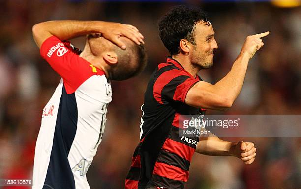 Mark Bridge of the Wanderers celebrates his third goal as Cameron Watson of Adelaide reacts during the round 12 ALeague match between the Western...