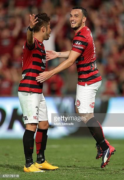 Mark Bridge of the Wanderers celebrates scoring a goal with team mate Yusuke Tanaka during the round 26 ALeague match between the Western Sydney...