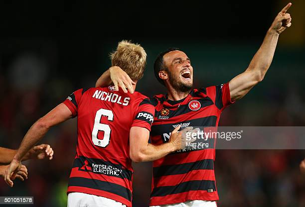 Mark Bridge of the Wanderers celebrates with Mitch Nichols of the Wanderers after scoring the first goal during the round 10 ALeague match between...