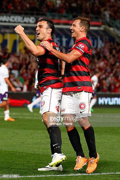 Mark Bridge of the Wanderers celebrates with team mate Brendon Santalab after scoring a penalty during the round 16 ALeague match between the Western...