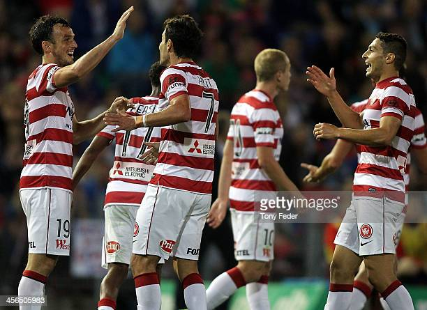 Mark Bridge of the Wanderers celebrates with team mates after scoring a goal during the round 10 A-League match between the Newcastle Jets and the...