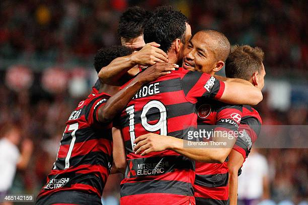 Mark Bridge of the Wanderers celebrates with team mates after scoring a penalty during the round 16 ALeague match between the Western Sydney...