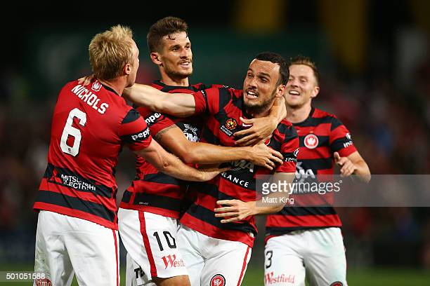 Mark Bridge of the Wanderers celebrates with team mates after scoring the first goal during the round 10 ALeague match between the Western Sydney...