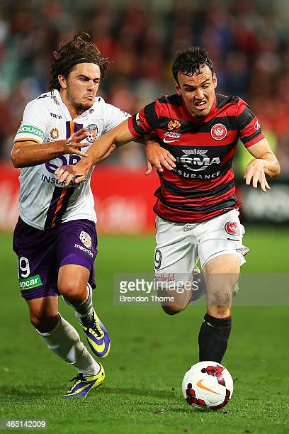 Mark Bridge of the Wanderers competes with Joshua Risdon of the Glory during the round 16 ALeague match between the Western Sydney Wanderers and...