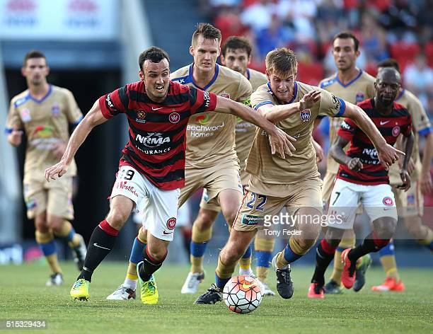 Mark Bridge of the Wanderers contests the ball with Lachlan Jackson of the Jets during the round 23 ALeague match between the Newcastle Jets and the...