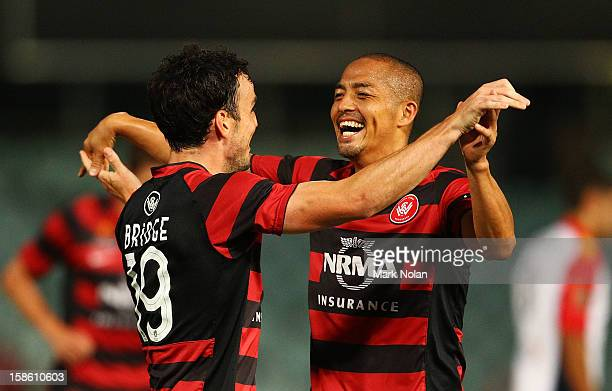 Mark Bridge of the Wanderers is congratulated by team mate Shinji Ono after scoring his third goal during the round 12 ALeague match between the...