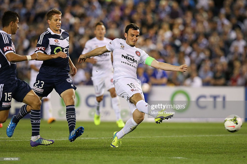 Mark Bridge of the Wanderers kicks a goal during the round one A-League match between Melbourne Victory and the Western Sydney Wanderers at Etihad Stadium on October 10, 2014 in Melbourne, Australia.
