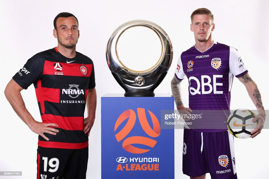 Mark Bridge of Western Sydney Wanderers and Andy Keogh of Perth Glory pose during the 2017/18 A-League Season Launch at Port Melbourne SC on October 3, 2017 in Melbourne, Australia.