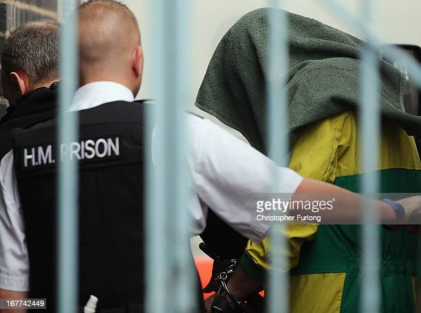 Mark Bridger arrives at Mold Crown Court covered with a blanket for the first day of his trial accused of the murder of April Jones on April 29 2013...