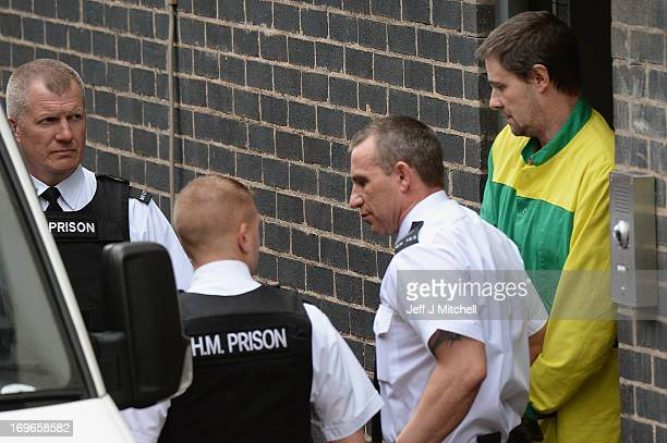 Mark Bridger is taken from Mold Magistrates Court after he was found guilty of the murder of April Jones on May 30 2013 in Mold United Kingdom The...