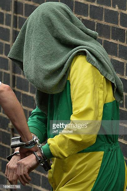 Mark Bridger is taken from Mold Magistrates Court with his head covered on May 29 2013 in Mold Wales The jury has currently been sent home for the...