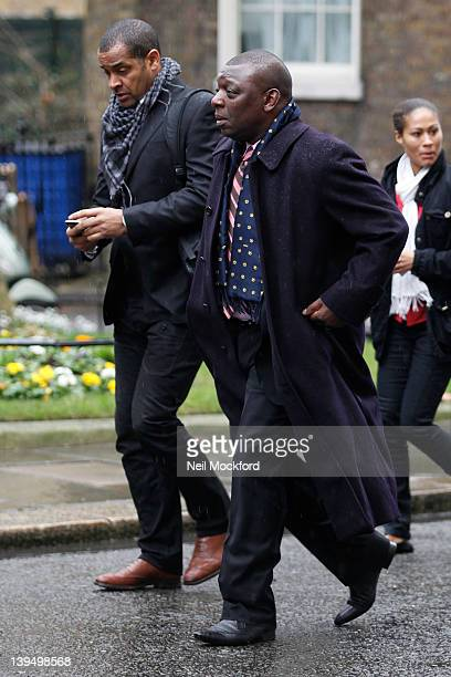 Mark Bright and Garth Crooks arrive for a meeting to discuss racism in football at 10 Downing Street on February 22 2012 in London England