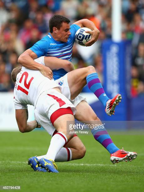 Mark Bright of England tackles Lee Jones of Scotland in the plate semi final match between Scotland and England during the Rugby Sevens at Ibrox...